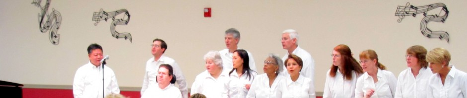 "a picture of the choir arranged and singing ""In the Still of the Night"""