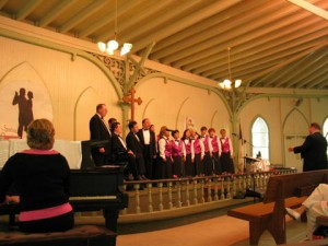 At center, the Starlite Chorale on stage at Bishop Janes' Tabernacle, Ocean Grove NJ